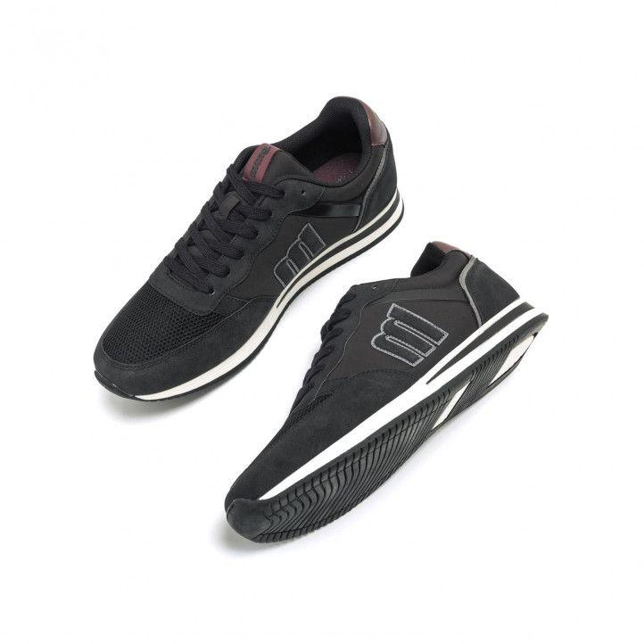 Zapatillas deportivas Mustang en color negro, con logo de la marca en el lateral combinada con diferentes - Querol online