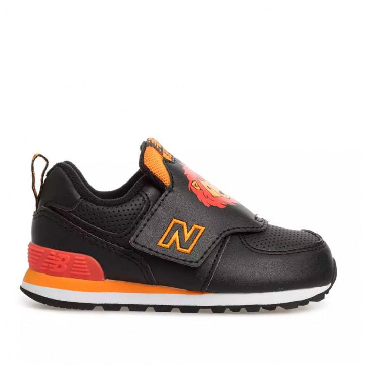 Zapatillas deporte New Balance negra con detalles en naranja y dibujo león - Querol online
