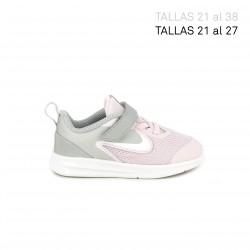 Zapatillas deporte Nike rosa y gris con suela flexible