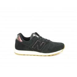 Zapatillas deportivas New Balance negras con detalles brillantes