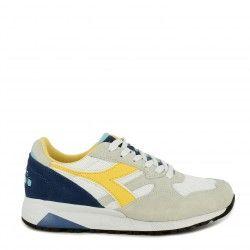 Zapatillas deportivas Diadora blancas con detales en azul y amarillo n902 s - Querol online